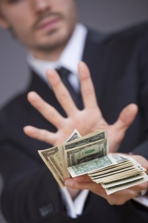 20091221-businessman-holding-up-hand-refusing-cash
